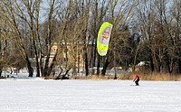 Man kiteboarding frozen lake winter active