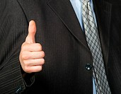 A photo of a hand doing a thumb up gesture