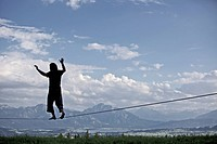 Young man balancing on a longline, Auerberg, Bavaria, Germany, Europe