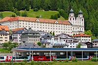 Benedictine monastery Disentis Abbey in the village of Disentis with train station and Glacier Express, Surselva, Graubuenden, Switzerland