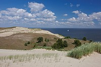Wandering dunes and sailing boat, Curonian Lagoon North of Pervalka, Curonian Spit, Baltic Sea, Lithuania, Europe