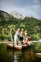 Children playing on a raft in a lake, Gossensass, Brenner, South Tyrol, Trentino_Alto Adige/Suedtirol, Italy