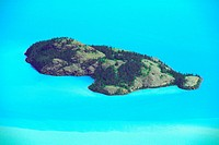 Rocky Island Amid Silt_Streaked Turquoise Waters