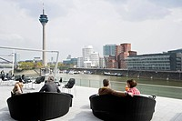 Cafe at the Media Harbour, television tower and buildings designed by Frank Gehry, Duesseldorf, North Rhine_Westphalia, Germany, Europe