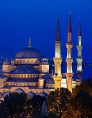 Three minarets of the lit Blue Mosque at dusk on the Bosphorus Sultanahmet Istanbul Turkey
