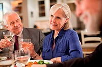 Mature woman at dinner party