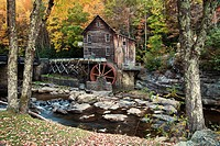 Mill on creek in forest