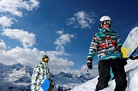 Snowboarders on snowy mountaintop