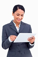 Close up of smiling saleswoman using her tablet computer
