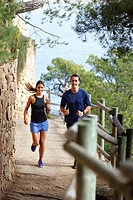 Couple running on dirt path