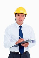 Male architect with clipboard and pen