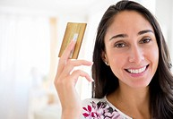 Caucasian woman holding credit card