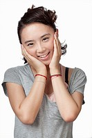 Smiling Chinese woman with head in hands
