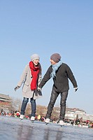Chinese couple ice skating together