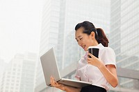 Chinese businesswoman carrying laptop