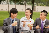 Chinese business people eating together outdoors