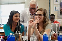 Students and teacher working in lab classroom