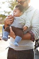 Father holding African American baby boy