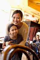 Filipino mother and daughter in cafe