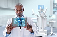 Black doctor looking at digital tablet