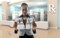 African American businesswoman using digital display in pharmacy