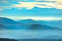 mountains and summits among a mist landscape