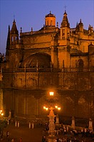 Cathedral, Plaza de los Reyes, at night, and lit lantern-fountain, Seville, Andalusia, Spain
