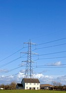 Electricity tower and detached house in rural area