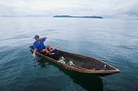 Man fishing in canoe type dugout boat, panama