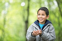 Male, elementary student discovering the outdoors