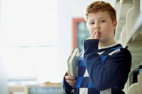Elementary student making be quiet gesture