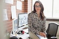 Pretty, female, industrial designer working in office.
