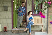 Middle_aged couple relaxing outdoors on porch