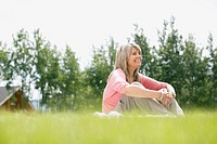 Middle_aged woman sitting in grassy area