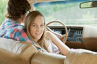 Young couple sitting close in a vintage car (thumbnail)