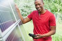 African-American man checking solar panel (thumbnail)
