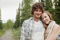 Attractive young couple posing on rural property