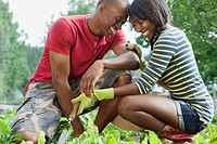 Couple being affectionate while working in garden