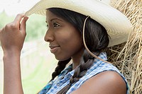 Pretty, African_American woman tipping her straw hat