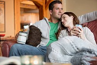 Mid_adult couple relaxing together with coffee