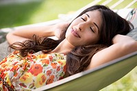Pretty woman taking a nap in hammock.