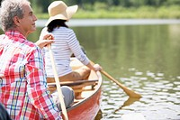 Mature couple canoeing together