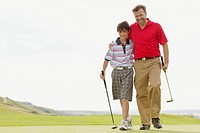 Father and son walking onto golf green together (thumbnail)