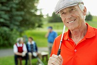 Portrait of senior golfer with golf club on tee-box (thumbnail)