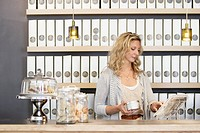 Woman standing behind counter