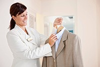 Chambermaid holding suit