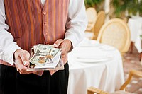 Waiter holding tray with receipt and cash