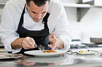 Male chef preparing meal in kitchen