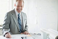 Businessman reviewing architectural plans