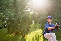 Young male baseball pitcher winding up to throw (thumbnail)